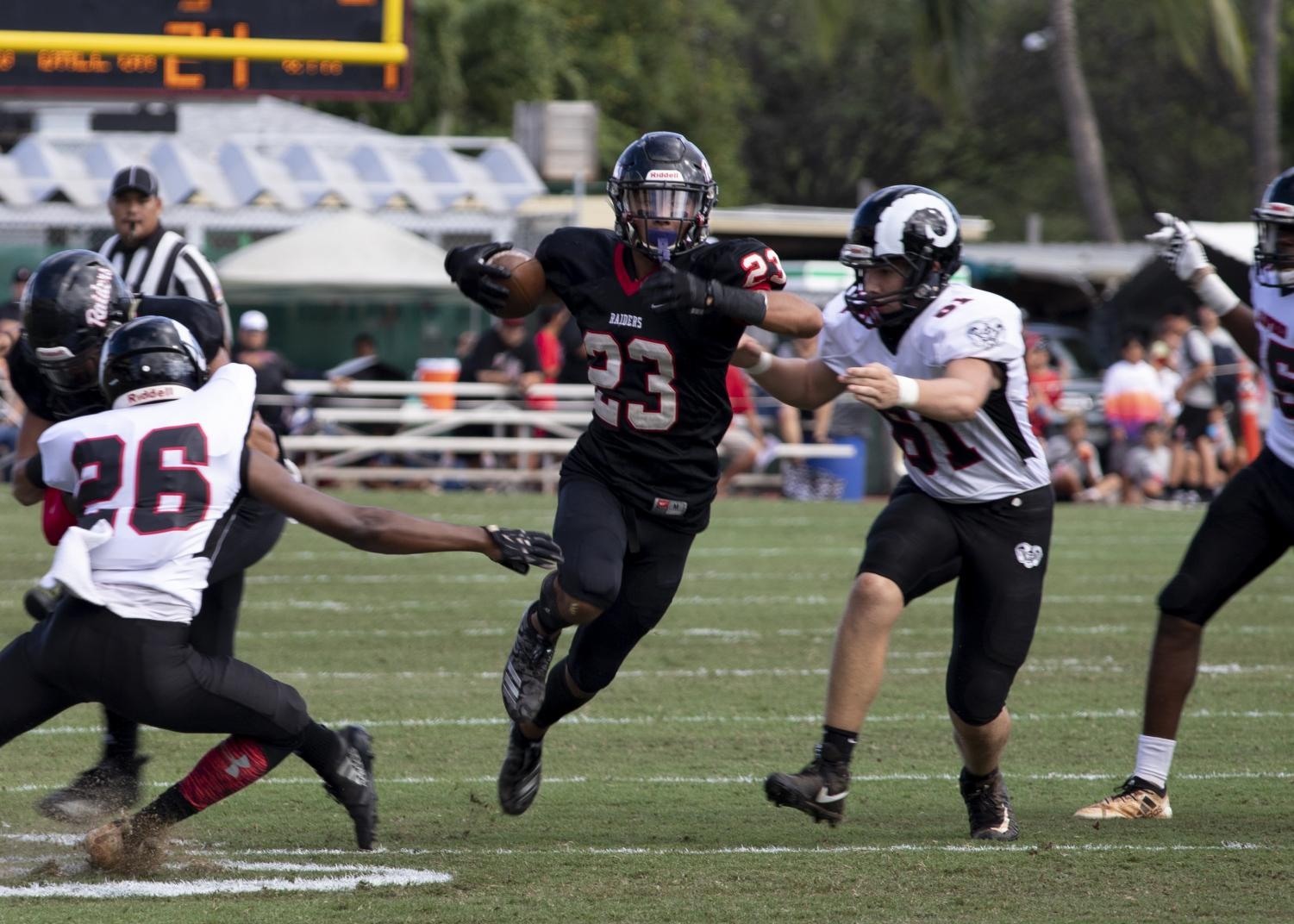 Lanakila Pei '20 returns a punt return against Radford during the Homecoming Game.