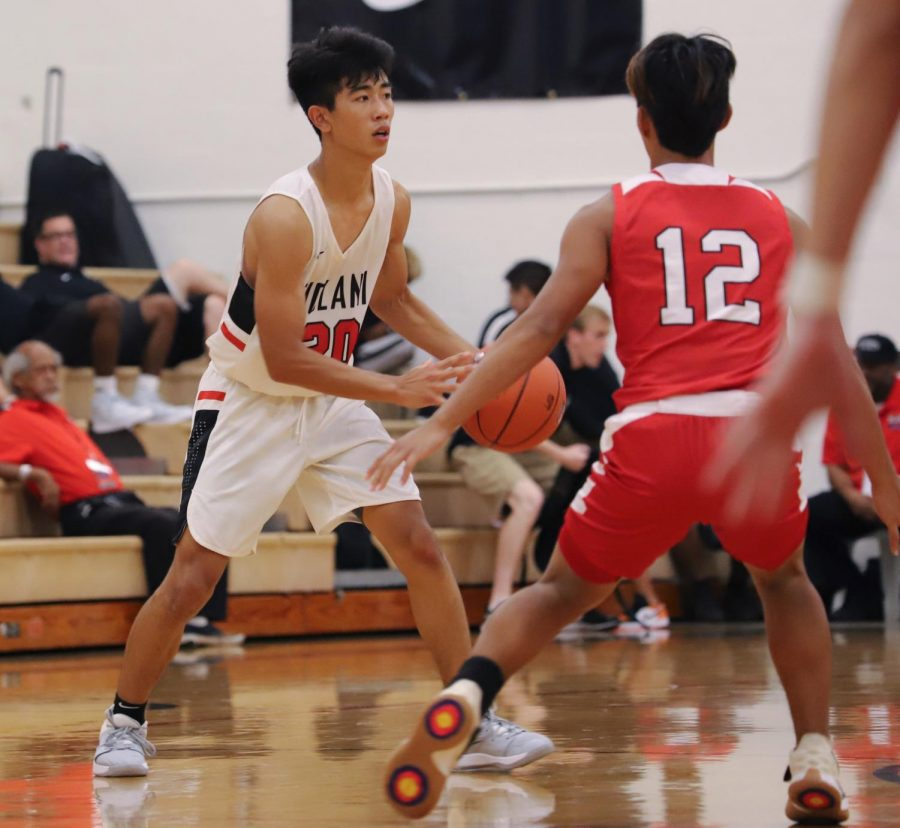 Wesley Yamada '20 dribbles down the court against Kalani