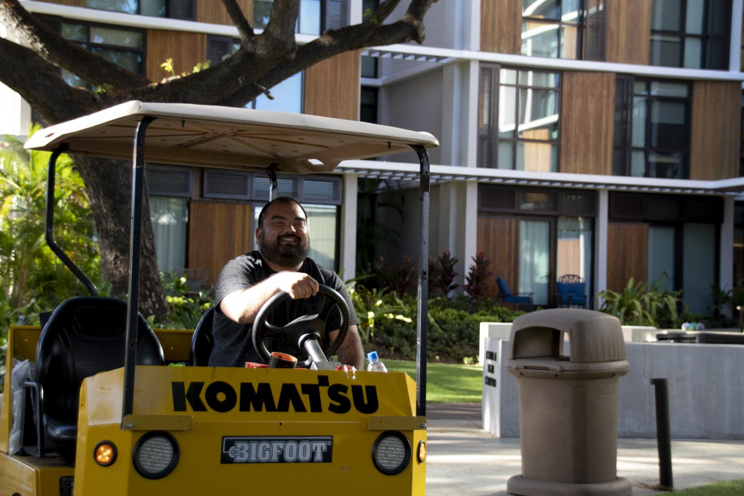 Mr. Kevin Tomisato '04 drives in his cart, tending to various matters around campus.