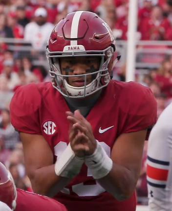 Tua Tagovailoa prepares to receive a snap.